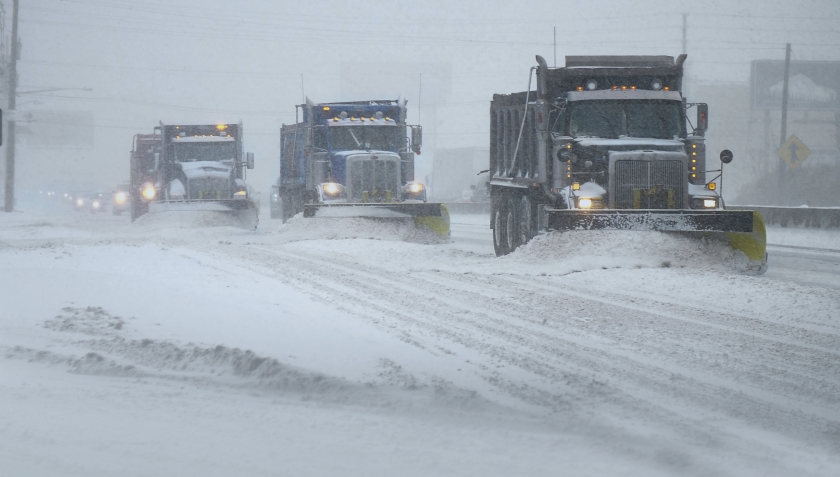 storyblocks-snow-plows-clearing-a-highway-during-a-snow-blizzard_B9O9Q5BVM.jpg